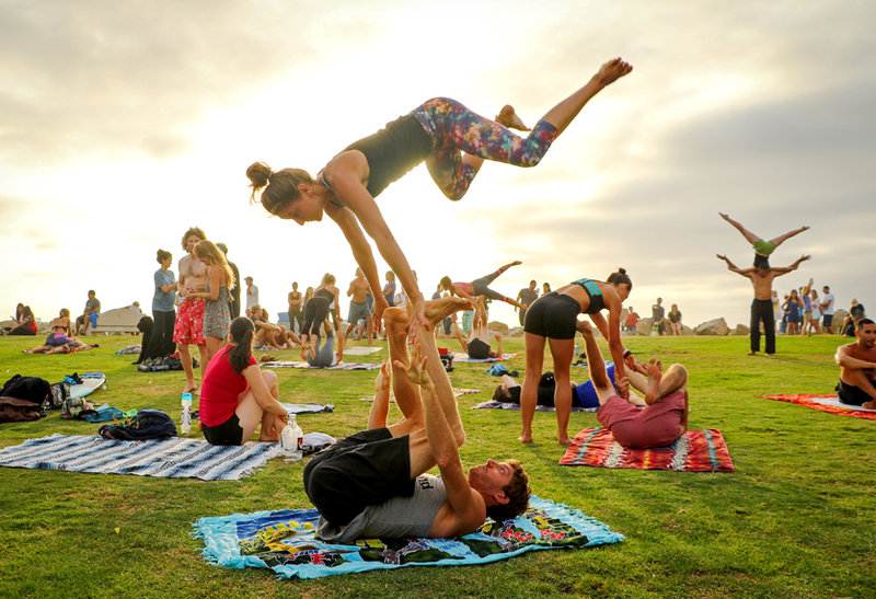 Pour yourself a glass of healthy wine and learn the basics of acroyoga.
